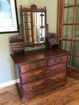 Six Drawer Cherry Wood Dresser with Pivoting Mirror in Wilmington, North Carolina