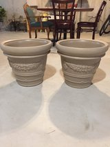 Matching tan flower pots in Joliet, Illinois