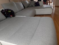 U shape couch with pullout bed and storage in Ramstein, Germany