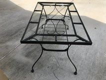 Iron table with tempered glass top in Conroe, Texas