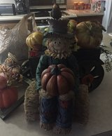 scarecrow selling pumpkins in Alamogordo, New Mexico