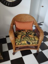 Wicker chair with custom seat cushion/throw pillow in Joliet, Illinois