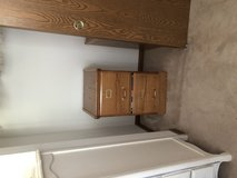 Identical wood file cabinets in Joliet, Illinois