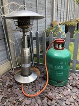 gas patio heater and empty gas bottle in Lakenheath, UK