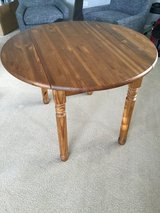 Expandable wood table from Pier One in Chicago, Illinois
