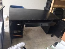 Large black desk with doors and shelves in Fort Hood, Texas