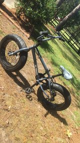 Mongoose Dirt Rider with oversized tires in Camp Lejeune, North Carolina