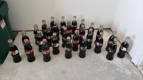 Coca-Cola Commemorative (Filled) Bottles in Conroe, Texas