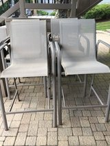 Set of 4 tan bar height patio chairs in Westmont, Illinois