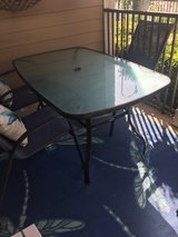 glass top patio table / no chairs in Houston, Texas