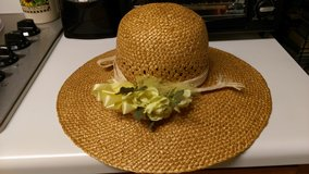 Wide brim straw hat in Byron, Georgia