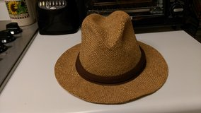 Straw hat with brown trim in Byron, Georgia