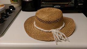 Straw hat with white trim in Byron, Georgia