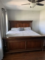 Solid wood King size bed with mattress in Camp Lejeune, North Carolina