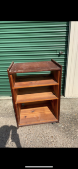 Solid wood roll around cart with 3 spaces + the top shelf for Tv - $20 obo in Spring, Texas