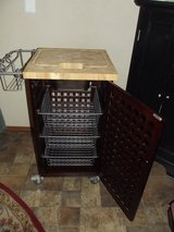 Two door storage cart with a butcher block top in Alamogordo, New Mexico