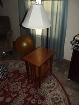 Side table with two shelves and attached lamp with shade. in Alamogordo, New Mexico