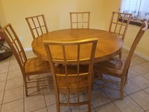 Solid wood dining table with 6 chairs in Kingwood, Texas