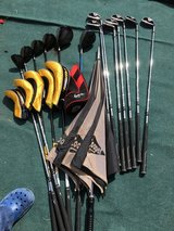 Golf clubs and drivers golf trolley and bag in Lakenheath, UK