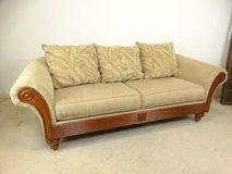 Tan-Colored Fabric Sofa with 3 Tropical Throw Pillows in Pearland, Texas