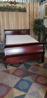 Full size cherry sleigh bed with pillowtop mattress set in Fort Campbell, Kentucky
