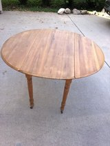 Antique drop leaf table in Chicago, Illinois