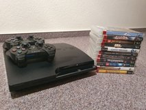 Black Sony Playstation 3, two controllers, eleven games. in Ramstein, Germany