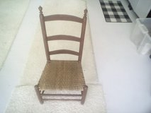 Old cane seat chair in Kingwood, Texas