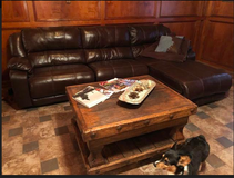 Brown faux leather reclining sectional-like new with rustic coffee table in Kingwood, Texas