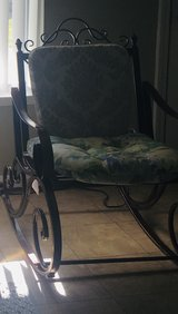 Outdoor wrought iron rocking chair in Fort Knox, Kentucky