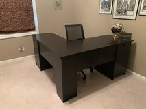 brown L-shaped desk in Chicago, Illinois