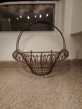 Large wrought iron wall hanging basket in Chicago, Illinois