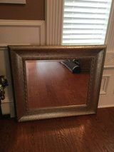 Gold toned mirror in Baytown, Texas