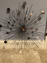 Metal and glass sunburst wall art in Chicago, Illinois