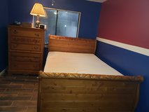 Queen size sleigh bed with Chester drawers and mattress in Pasadena, Texas