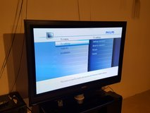Philips TV (at least 50 Inch) (TV Stand included) in Aurora, Illinois