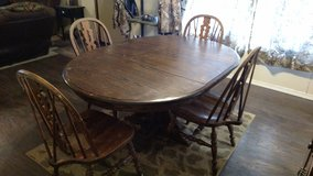 Solid oak dining table with four chairs in Alamogordo, New Mexico