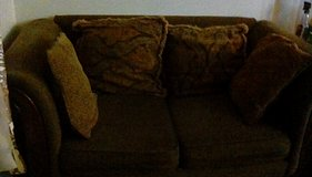 Brown Cloth CouchWith wood trim in Tacoma, Washington