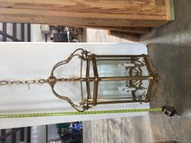 Brass entryway chandelier in Spring, Texas