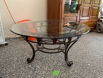 Glass top round coffee table with iron work in Plainfield, Illinois