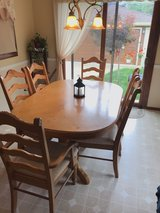 Table and 6 chairs, with hutch in Joliet, Illinois