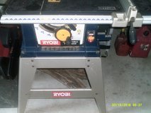 """RYOBI 10"""" TABLE SAW WITH STAND, A EXTENSION PULL OUT TO EXTEND TNE TABLE WITH ATTACHMENT , in Naperville, Illinois"""