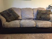 tan and brown leather and microfiber couch in Camp Lejeune, North Carolina
