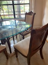 Vintage glass table, sits four has cast iron railing that sits on marble base in Eglin AFB, Florida