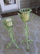 Two green candleabras hood for pillar candles in Wilmington, North Carolina