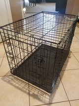 Dog crate with removable divider in Kingwood, Texas