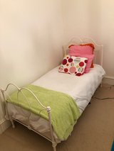 White wicker and iron twin bed, dresser, shelf, night stand with sheets and duvet in Quantico, Virginia