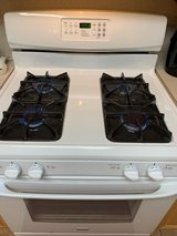 Kenmore gas stove and over the range microwave in Kingwood, Texas