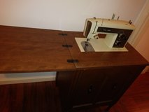 Sewing machine in cabinet in The Woodlands, Texas