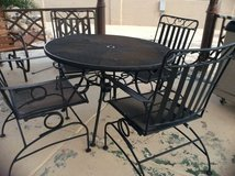 Black metal table and chairs in Alamogordo, New Mexico